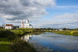 Abandonded Church Reflecting in the Kamenka River in the UNESCO World Heritage Site Photographic Print by Michael Runkel
