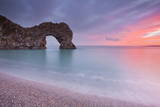 A Colourful Sunset over Durdle Door Photographic Print by Julian Elliott