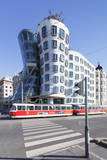 Tram in Front of the Dancing House (Ginger and Fred) by Frank Gehry Photographic Print by Markus Lange