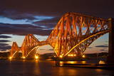 Forth Rail Bridge over the River Forth Illuminated at Night Photographic Print by Neale Clark