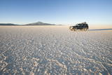 Jeep Traveling across Salt Flats at Sunset, Salar De Uyuni, Bolivia, South America Photographic Print by Kim Walker