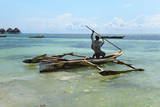 Fisherman and Traditional Outrigger Boat Photographic Print by Peter Richardson