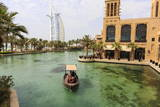 Dhows Cruise around the Madinat Jumeirah Hotel Photographic Print by Amanda Hall