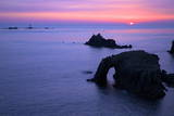 Sunset at Longships Lighthouse Photographic Print by Peter Barritt
