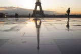 A Man Playing a Saxophone in Front of the Eiffel Tower, Paris, France, Europe Photographic Print by Julian Elliott