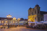 Roman Catholic Cathedral and Outdoor Cafes in Piata Unirii at Dusk Photographic Print by Ian Trower