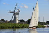 Sailing Boat in Front of Thurne Dyke Drainage Mill Photographic Print by Peter Richardson