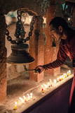 A Buddhist Monk Rings a Prayer Bell During the Full Moon Celebrations Photographic Print by Andrew Taylor