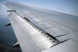 View of a Passenger Plane's Wing from Inside the Cabin Photographic Print by Vlad Kharitonov