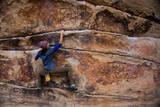 A Woman Climbs Gunsmoke V3 in Joshua Tree National Park Photographic Print by Ben Horton