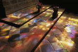 Stained Glass Windows Cast Colored Lights onto a Church Floor in Lacronan, Brittany, France Photographic Print by Jim Richardson