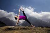 Cory Richards - A Woman Practices a Side Plank Pose or Vasisthasana in Phortse Fotografická reprodukce