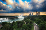 A Panoramic View Showing the Scale of Niagara Falls Against the Nearby Cityscape Photographic Print by Robbie George