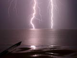Lightning Strikes the Sea Photographic Print by Olivier Matthys