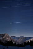 Stars Move over a Clear Sky During a Hours Long Time Exposure in Arosa Photographic Print by Alessandro Della Bella