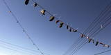 Shoes Hanging from Electrical Wire in the Silwan Neighborhood in Arab East Jerusalem Photographic Print by Jim Hollander
