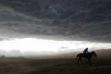 A Mongolian Herder Ride for Shelter in a Sudden Rainstorm Photographic Print by How Hwee Young