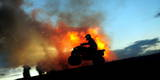 A Man Ride His Atv Next to a Bonfire During the Celebration of Shrovetide Photographic Print by Vassil Donev