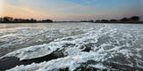 Drift Ice Flows Downstream on the German-Polish Border River Oder Near Reitwein Photographic Print by Patrick Peul