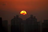 Sunset Following a Rainstorm with Residential and Commercial Buildings Seen Beneath in Beijing Photographic Print by Michael Reynolds