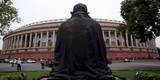 Rear View of the Mahatma Gandhi Statue in Front of the Indian Parliament House Photographic Print by Harish Tyagi