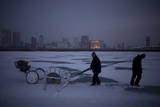 Men Cut Ice Blocks Off the Frozen Songhe River in Harbin Photographic Print by Diego Azubel