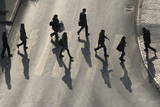 Pedestrians Cast their Shadows as They Cross a Street Photographic Print by Valdrin Xhemaj