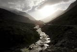 A Sunset over the Gez River in the Kunlun Mountains Photographic Print by Michael Reynolds