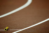 A Batton Lays on the Track Prior to the Men's 4X100M Relay at in Osaka, Japan Photographic Print by Kerim Okten