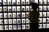 Japanese Visitor Looks at Gandam Robot Dolls on Display in Tokyo, Japan Photographic Print by Everett Kennedy