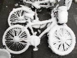Bicycles are Transformed into Fluffy White Sculptures as a Freak Snow Storm Hits Beijing Photographic Print by Adrian Bradshaw