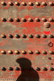 A Visitor at the Forbidden City Casts a Shadow as He Walks by an Intricate Gate Photographic Print by Michael Reynolds