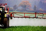 A Farmer Spraying Pesticides on His Field Photographic Print by Patrick Peul