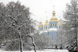 An Ukrainian Man Walks in Front of Mikhaylovskiy Gold Domes Cathedral in Downtown Kiev, Ukraine Photographic Print by Sergey Dolzhenko