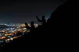 Two Muslim Pilgrims Pray on the Ghar Heraa Mountain in Mecca, Saudi Arabia Photographic Print by Yahya Arhab