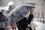 A Woman Takes a Photograph from under an Umbrella Near Trafalgar Square, London, England Photographic Print by Frantzesco Kangaris
