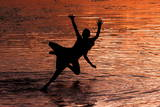 Kashmiri Boys Jump into Dal Lake to Beat the Heat as Sun Sets in Srinagar Photographic Print by Altaf Qadri