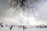 People Enjoy a Skating Afternoon on the Frozen Horgener Pond Above Horgen Near Zurich Photographic Print by Walter Bieri