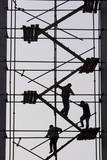 Workers Walk on Wooden Planks Among Scaffolding as the Climb Down at a Construction Site in Beijing Photographic Print by Diego Azubel