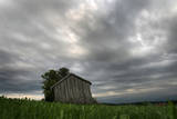 A Lone Old Barn as Dark Clouds Pass over the Landscape Photographic Print by Karl-Josef Hildenbrand