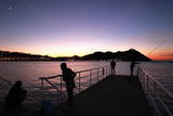 People Enjoy the Sunset at Nautic Club in San Sebastian Photographic Print by Javier Etxezarreta