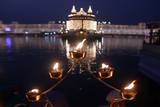 Lamps are Lit Near the Sacred Pond of the Illuminated Golden Temple in India Photographic Print by Raminder Pal Singh