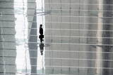 Japanese Businessman Stands the Foyer of a Modern Office Building in Downtown Tokyo Photographic Print by Everett Kennedy