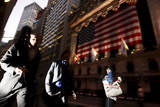 People Walk Past the New York Stock Exchange in Wall Street Sign in New York, USA Photographic Print by How Hwee Young