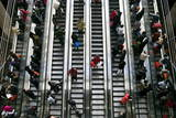 Travelers Take the Escalators on their Way to Catch the Train at the Beijing West Railway Station Photographic Print by Diego Azubel