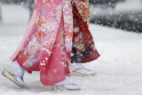 Young Japanese Women Walk Through the Snow in Tokyo, Japan Photographic Print by Kiyoshi Ota