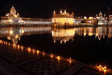 Sacred Lamps are Lit Along the Sacred Pond of the Illuminated Golden Temple Photographic Print by Raminder Pal Singh