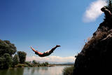An Ethnic Albanian Boy Jumps into the River of Drini, Near the Western Town of Djakovica, Serbia Photographic Print by Valdrin Xhemaj