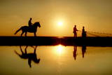 A Palestenian Rides His Horse on the Beach During Sunset in Gaza City Photographic Print by Ali Ali