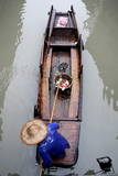 A Chinese Worker Collects Small Debris Along a Canal in Wuzhen, Zhejiang Province, China Photographic Print by Michael Reynolds
